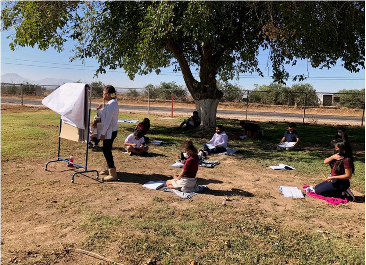 Staff members and students in Arizona's Stanfield school district have made frequent use of outdoor spaces during the pandemic. Here, in November, a third-grade class had a snack and learning time outside.