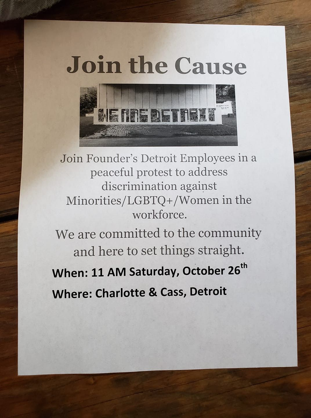"""The flier says """"Join the cause"""" and lists details of the event with a photo of street art that says """"We are Detroit."""""""
