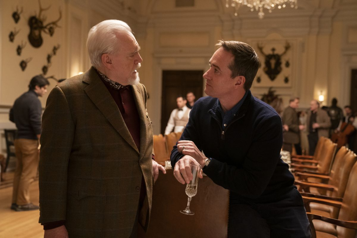Logan (Cox) and Tom (Macfadyen) talk in the dining room, at the head of the table.