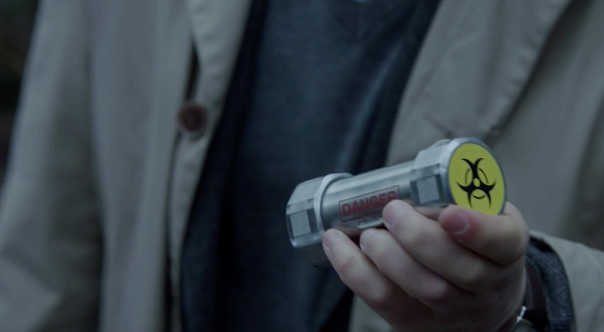 A vial with a yellow hazard sticker