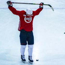 Nicklas Backstrom stretches ahead of Capitals morning skate.