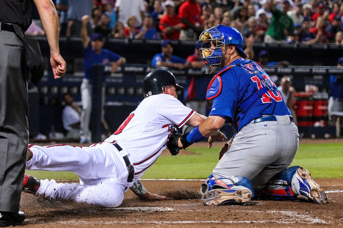Atlanta, GA, USA; Atlanta Braves third baseman Chipper Jones is tagged out at home by Chicago Cubs catcher Geovany Soto at Turner Field. Credit: Daniel Shirey-US PRESSWIRE