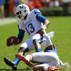 Kentucky quarterback Jalen Whitlow (13) is tackled by Florida defensive back Jeremy Brown during the second half of an NCAA college football game, Saturday, Sept. 22, 2012, in Gainesville, Fla.