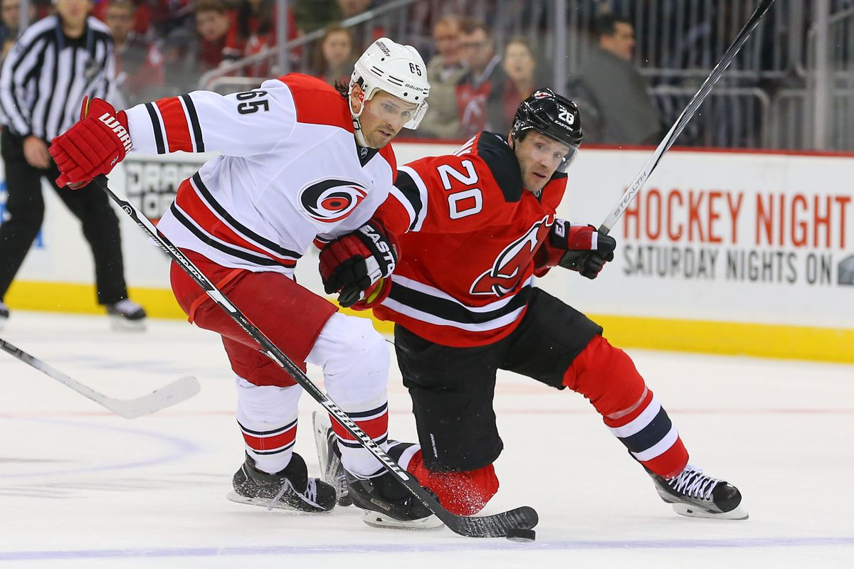Lee Stempniak battles with Ron Hainsey in NHL action
