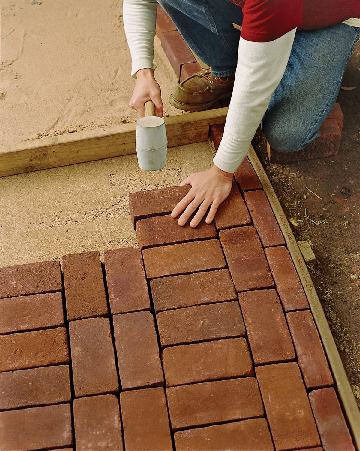 Man Fills In Pathway With More Bricks
