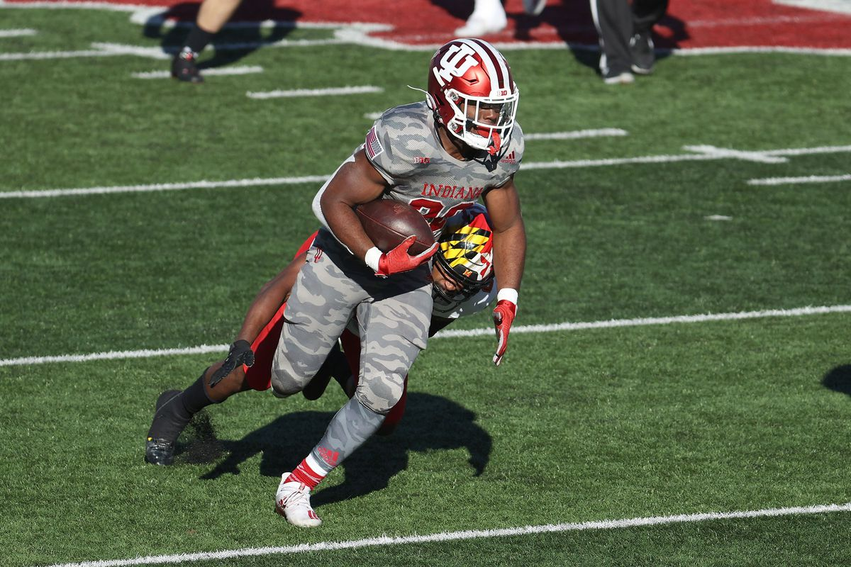 Tim Baldwin Jr of the Indiana Hoosiers runs with the ball against the Maryland Terrapins during the game at Memorial Stadium on November 28, 2020 in Bloomington, Indiana.