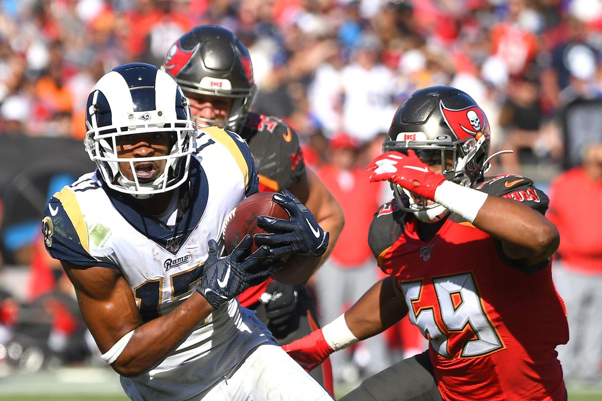 Los Angeles Rams wide receiver Robert Woods runs for a first down against Tampa Bay Buccaneers linebacker Devante Bond in the second half at the Los Angeles Memorial Coliseum.