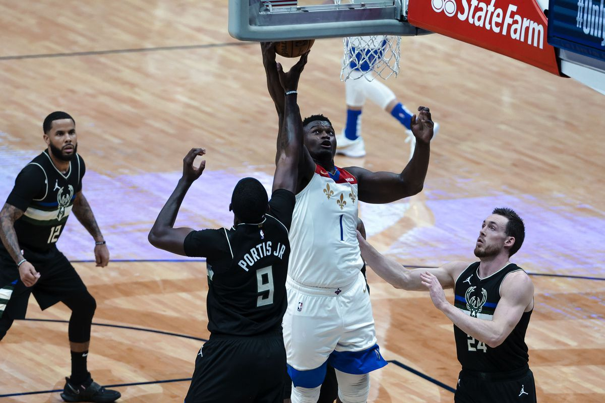 New Orleans Pelicans forward Zion Williamson (1) shoots over Milwaukee Bucks center Bobby Portis (9) and guard Pat Connaughton (24) during the second quarter at the Smoothie King Center.