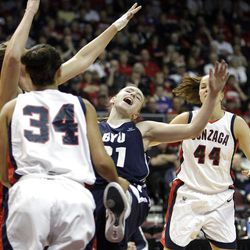 Brigham Young Cougars guard Lexi Eaton (21) is fouled by Gonzaga Bulldogs forward Shannon Reader (31)  in the West Coast Conference finals in Las Vegas  Monday, March 5, 2012.  BYU won the title and will advance to the NCAA tournament.