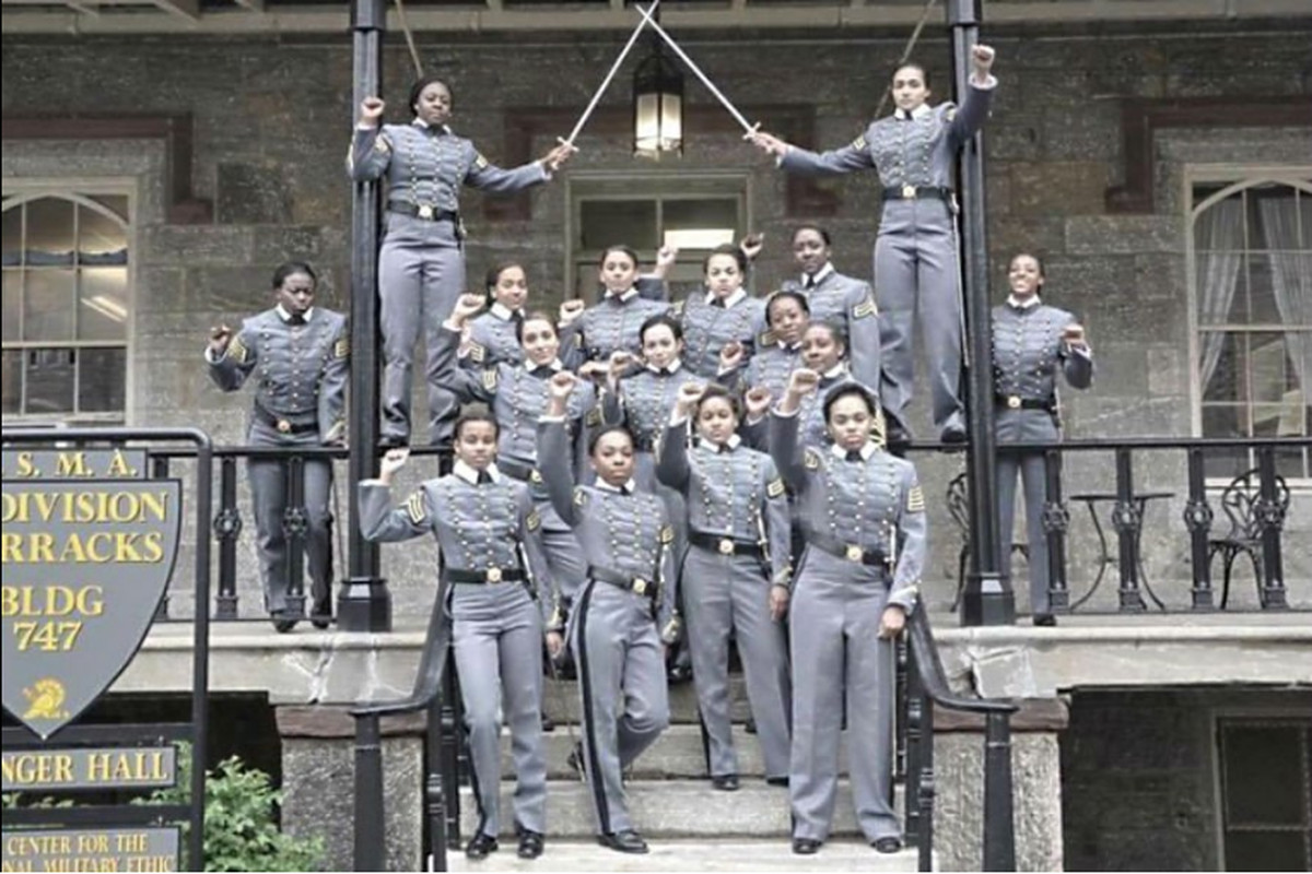 Sixteen black West Point cadets were cleared of violating Department of Defense policy for posing with a raised fist in uniform.