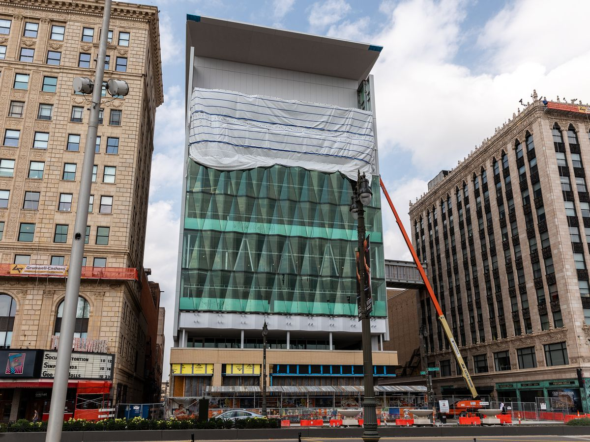 Teal pizza-slice windows on Detroit building are only partially installed