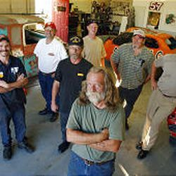 President Johnny Vine, front, and members of Team Vibrate take a break in their Ogden shop with some of the vehicles they roll \\\\— on purpose.