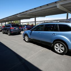 Multiple cars line up in the parking lot of the Utah Olympic Oval during a Hometown Day drive-thru event in Kearns on Saturday, Aug. 8, 2020.During the event, residents were given a washable Kearns masks to support the fight against COVID-19, visited with elected leaders and candidates, and entered a drawing for prizes.