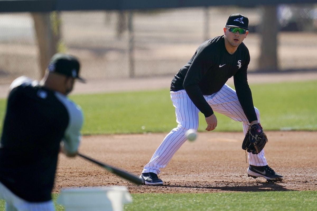 White Sox bench coach Miguel Cairo hits a grounder to third baseman Jake Burger.
