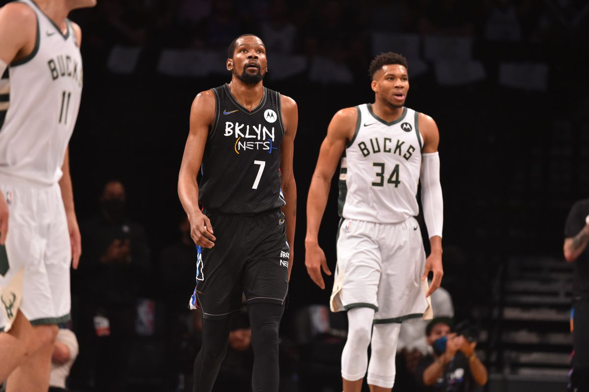 Kevin Durant #7 of the Brooklyn Nets and Giannis Antetokounmpo #34 of the Milwaukee Bucks look on during Round 2, Game 2 on June 7, 2021 at Barclays Center in Brooklyn, New York.