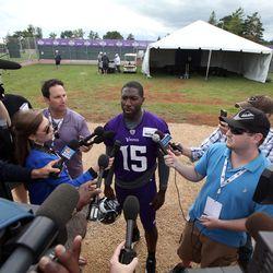 Jul 26, 2013; Mankato, MN, USA; Minnesota Vikings wide receiver Greg Jennings (15) talks to the media during training camp at Minnesota State University. Mandatory Credit: Brace Hemmelgarn-USA TODAY Sports