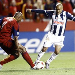 Jamison Olave of Real Salt Lake fights for control of the ball against Humberto Suazo from the Rayados of Monterrey during the final game of the CONCACAF championship at Rio Tinto Stadium in Sandy Wednesday, April 27, 2011.