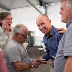 Gov. Spencer Cox talks with attendees at the Greek Festival in Salt Lake City on Friday, Sept. 10, 2021.