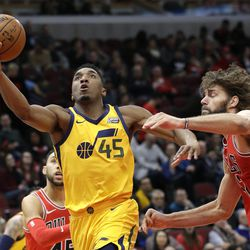 Utah Jazz guard Donovan Mitchell, left, drives to the basket against Chicago Bulls center Robin Lopez during the second half of an NBA basketball game Wednesday, Dec. 13, 2017, in Chicago. The Bulls won 103-100. (AP Photo/Nam Y. Huh)