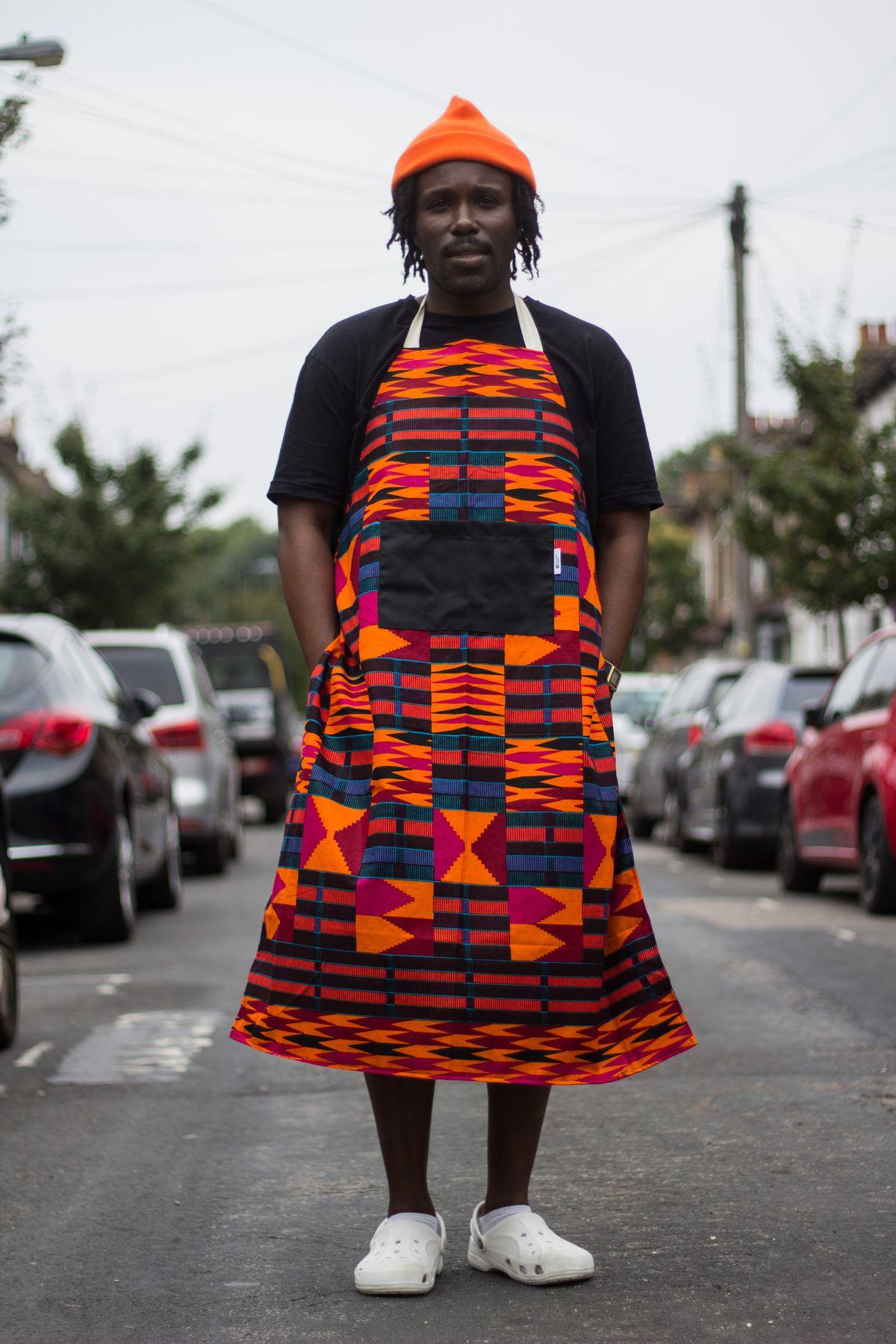 Akwasi Brenya-Mensa stands in a road