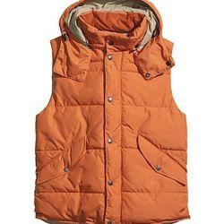 "<strong>H&M</strong> Padded Vest in Orange, <a href=""http://www.hm.com/us/product/09473/?article=09473-F&cm_mmc=pla-_-us-_-men_jackets_coats_jackets-_-09473&gclid=CJ-Cqeq9qroCFVSZ4AodFAkAVA"">$49.95</a>"