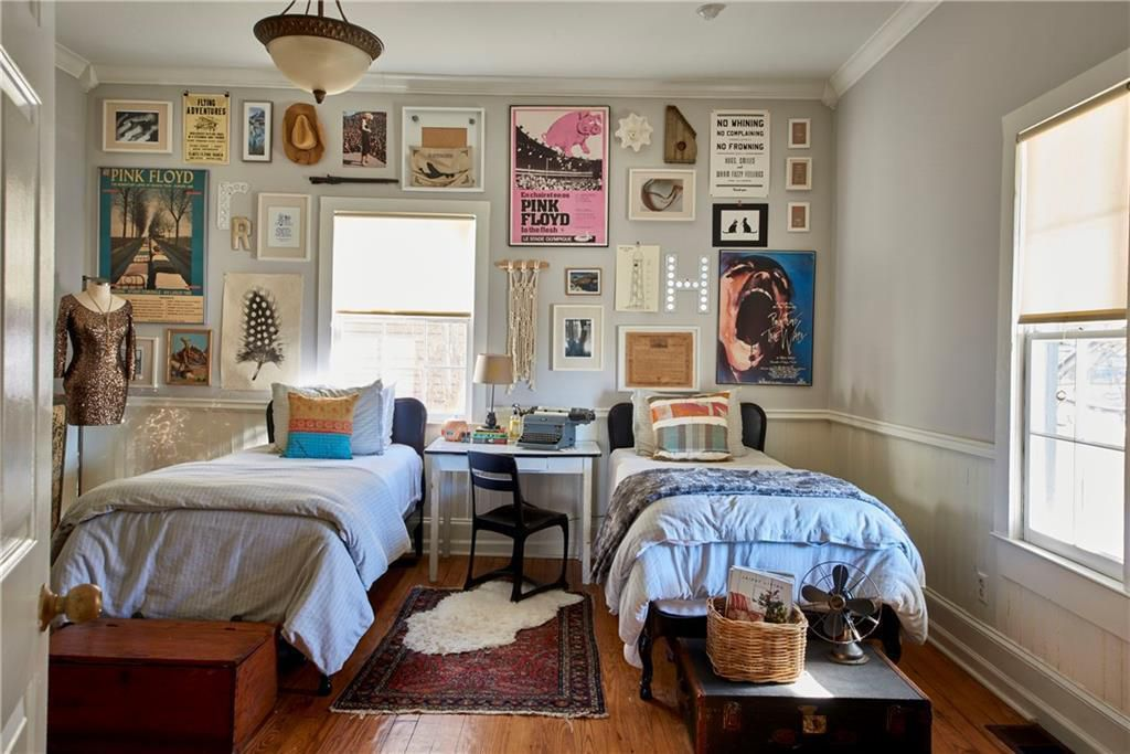 A bedroom space with Pink Floyd paraphernelia on the walls.