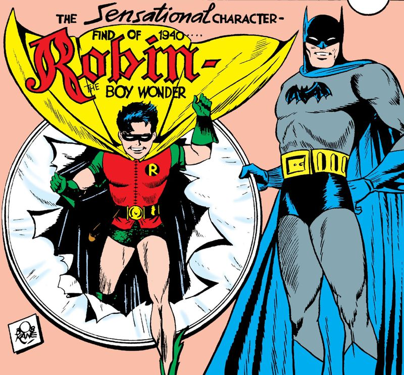 Batman holds a paper covered hoop, as Robin bursts out of it, on the cover of Detective Comics #38, DC Comics (1940).