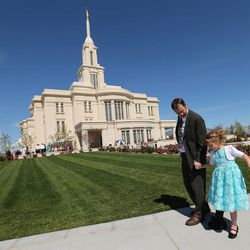 Jason and Madison Binks walk the temple grounds after the Payson Utah Temple cornerstone ceremony and dedication in Payson  Sunday, June 7, 2015.