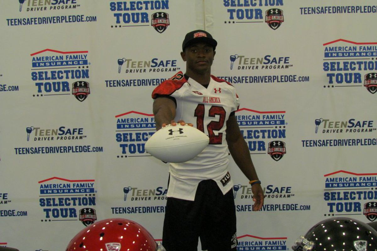 Texas commit Johnathan Gray shows off the Under Armour jersey he was presented at his high school on Wednesday.