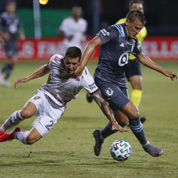 Real Salt Lake defender Aaron Herrera (22) and Minnesota United midfielder Robin Lod, right, battle for the ball during the first half of a soccer match in Kissimmee, Fla., Friday, July 17, 2020.