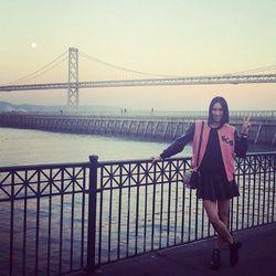 "Eva Chen poses in front of the Bay Bridge in her monogrammed varsity jacket; all photos via her <a href=""http://instagram.com/evachen212"">Instagram</a>"