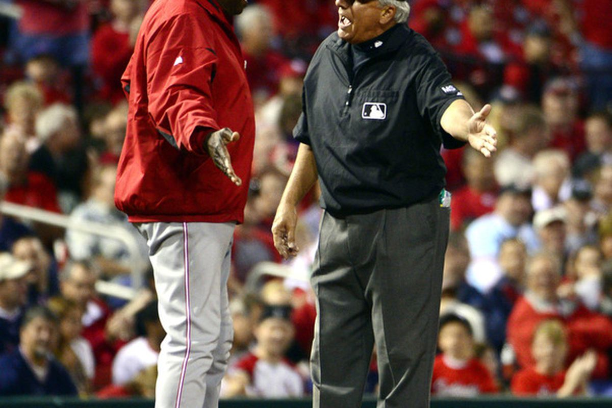 """Third base umpire Larry Vanover explains that a hit is one way for a batter to reach base safely. Striking a ball toward an open space in the outfield is one way to achieve this, to which Dusty Baker replied, """"But we don't wanna."""""""