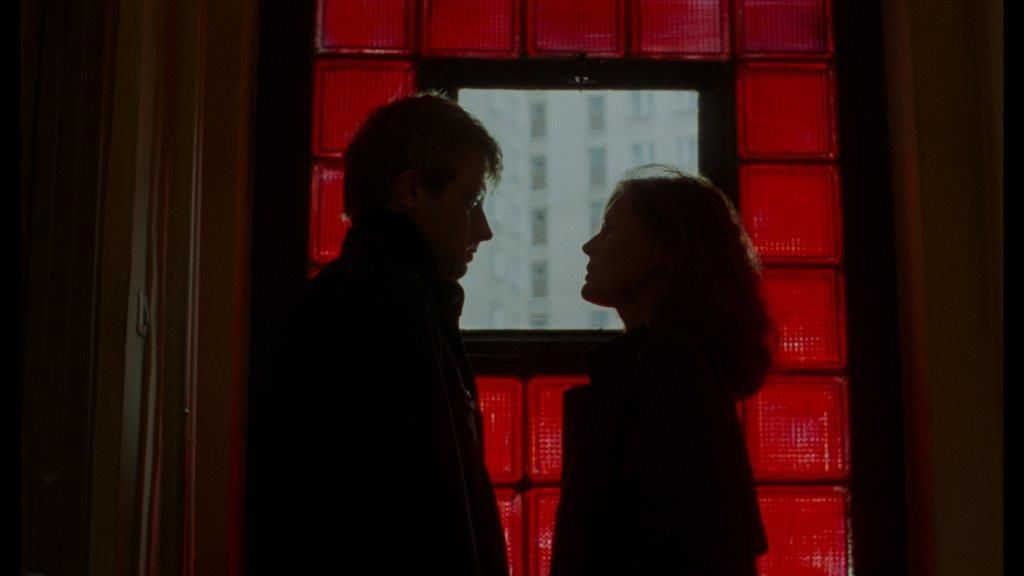 A man and a woman speak in silhouette, in a scene from the sixth Decalogue film.