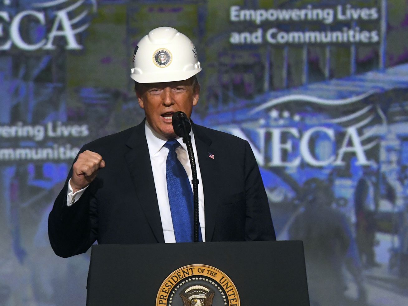 President Trump wears a hard hat as he addresses the National Electrical Contractors Convention on October 2, 2018, in Philadelphia.