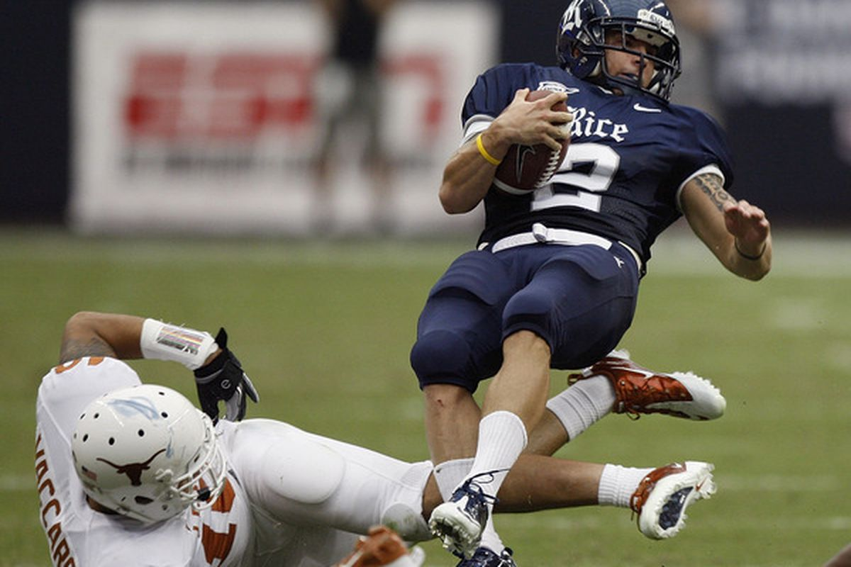 HOUSTON - SEPTEMBER 04:  Running back Sam McGuffie #2 of the Rice Owls is tripped up by safety Kenny Vaccaro #16 of the Texas Longhorns at Reliant Stadium on September 4 2010 in Houston Texas.  (Photo by Bob Levey/Getty Images)