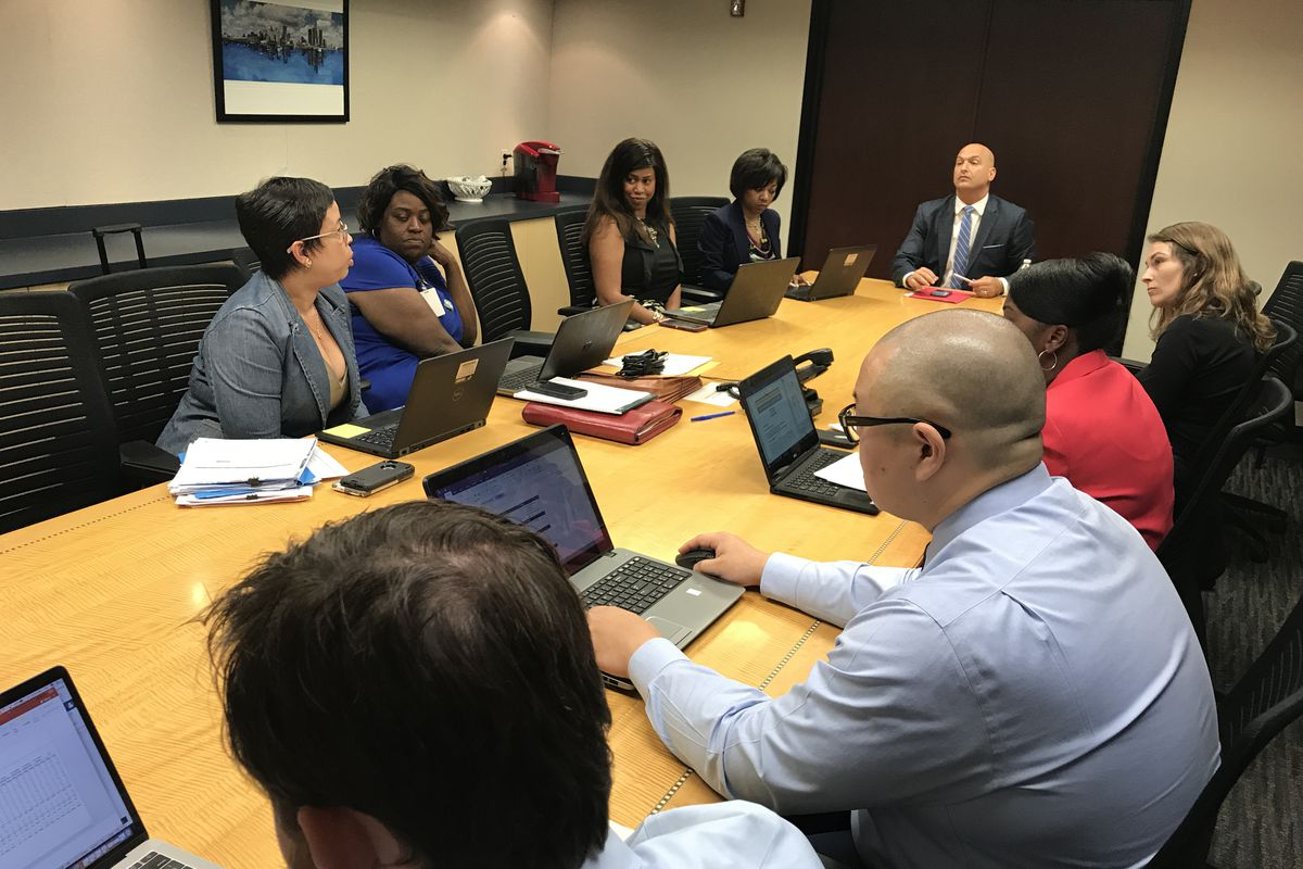 Detroit schools Superintendent Nikolai Vitti leads a meeting of advisers in a conference room adjacent to his office in Detroit's Fisher Building in August 2017.