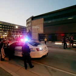 West Valley police officers respond as a protest at the West Valley City Police Department is disrupted by counterprotesters on Wednesday, Sept. 16, 2020.