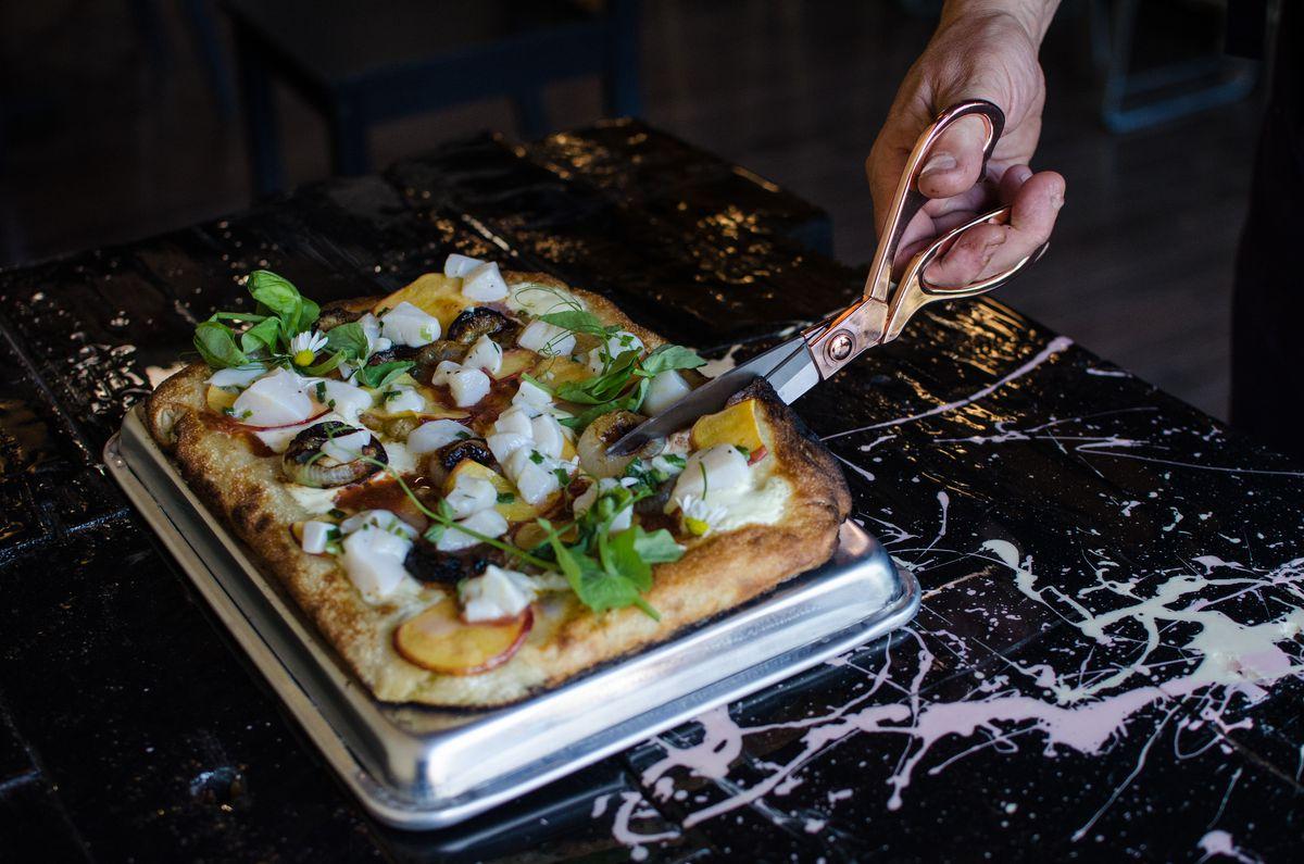T&B Pizza's scallop ceviche Roman-style pizza, a white pizza with roasted peaches, ricotta, and cipollini