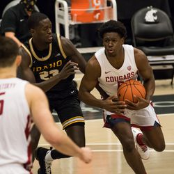PULLMAN, WA - DECEMBER 9: Washington State guard TJ Bamba (5) looks to pass the ball during the first half of the Battle of the Palouse rivalry between the Idaho Vandals and the Washington State Cougars on December 9, 2020, at Beasley Coliseum in Pullman, WA.