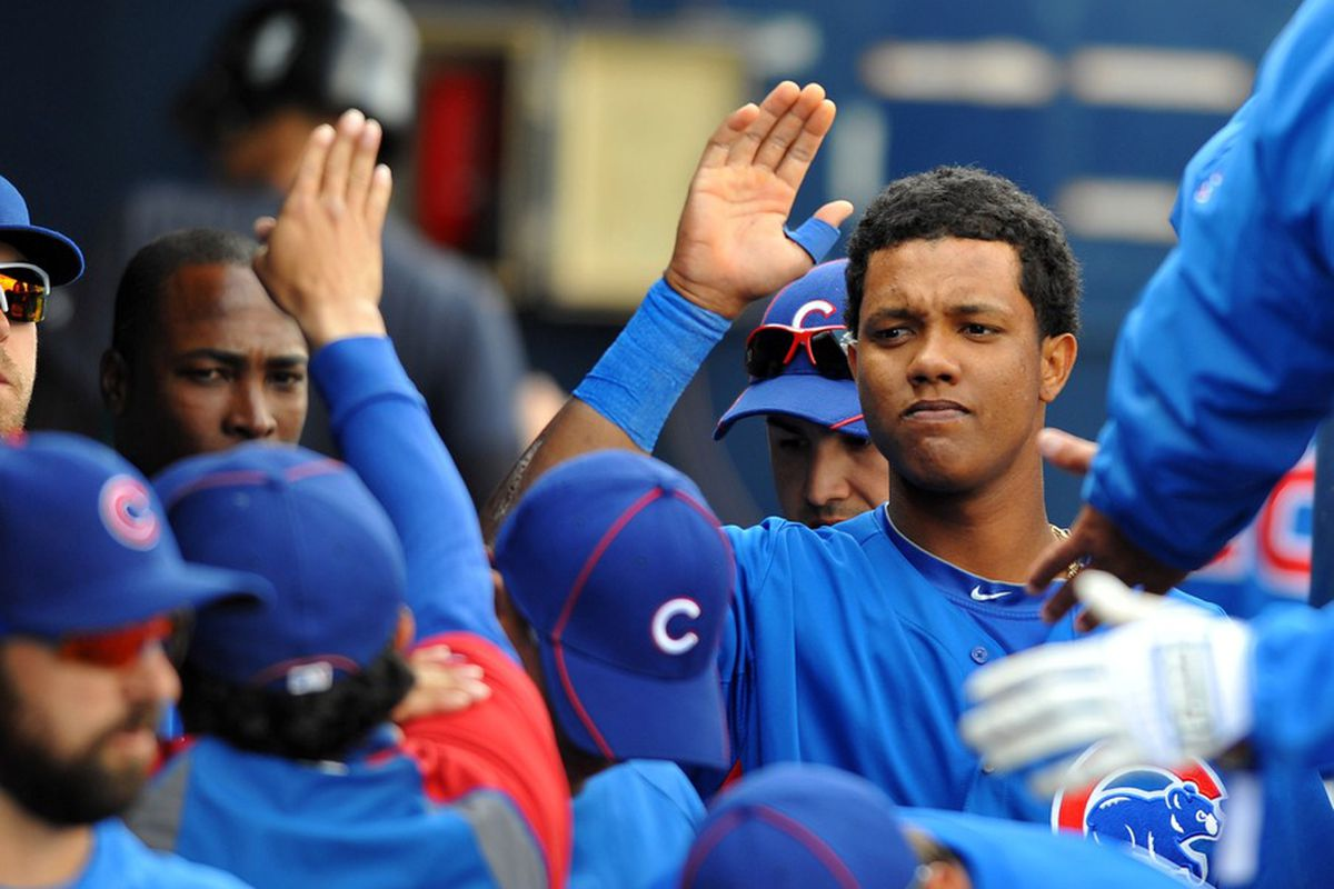 Peoria, AZ, USA;  Chicago Cubs shortstop Starlin Castro is congratulated by teammates after scoring during the first inning against the Seattle Mariners at Peoria Stadium. Mandatory Credit: Christopher Hanewinckel-US PRESSWIRE