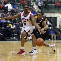 Curie's Trevon Hamilton (5) tips the balll away from Orr's Tyler Bullock (3) in their CPS semi final game at Chicago State University, Friday, February 15, 2019. | Kevin Tanaka/For the Sun Times