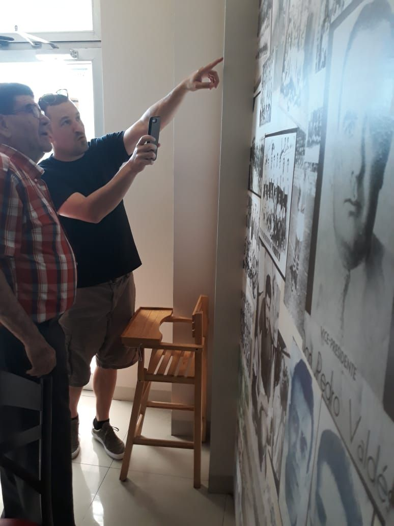"""Owner Jesús """"Chuy"""" Aranzábal (left) and I talking about the different photos on the wall of Patachueca."""