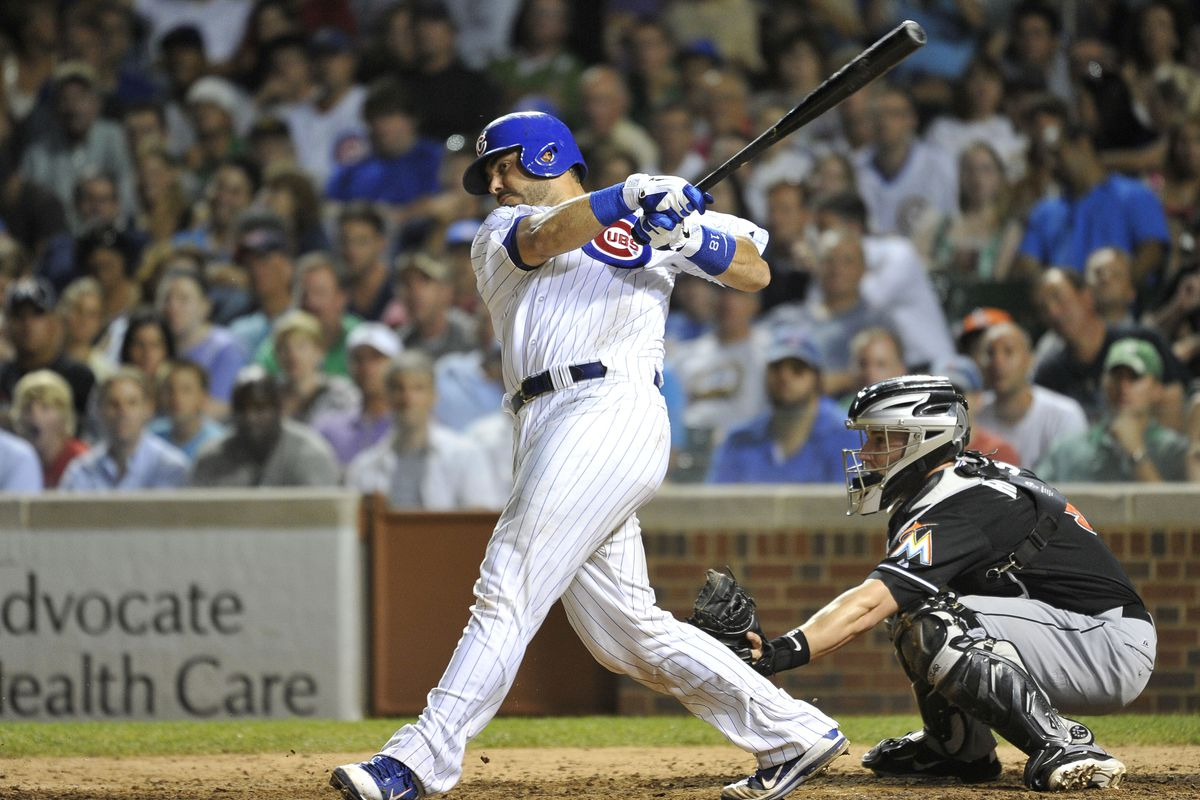 Geovany Soto of the Chicago Cubs follows through on an RBI single scoring teammate Alfonso Soriano as Brett Hayes of the Miami Marlins catches at Wrigley Field in Chicago, Illinois.  (Photo by Brian Kersey/Getty Images)