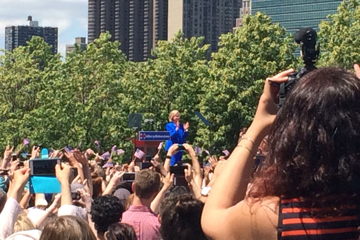 Hillary Clinton greets the crowd at her speech on Roosevelt Island in New York Saturday.