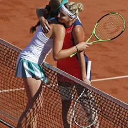Timea Bacsinszky of Switzerland, right, congratulates Latvia's Jelena Ostapenko with winning the semifinal match of the French Open tennis tournament at the Roland Garros stadium, in Paris, France. Thursday, June 8, 2017.