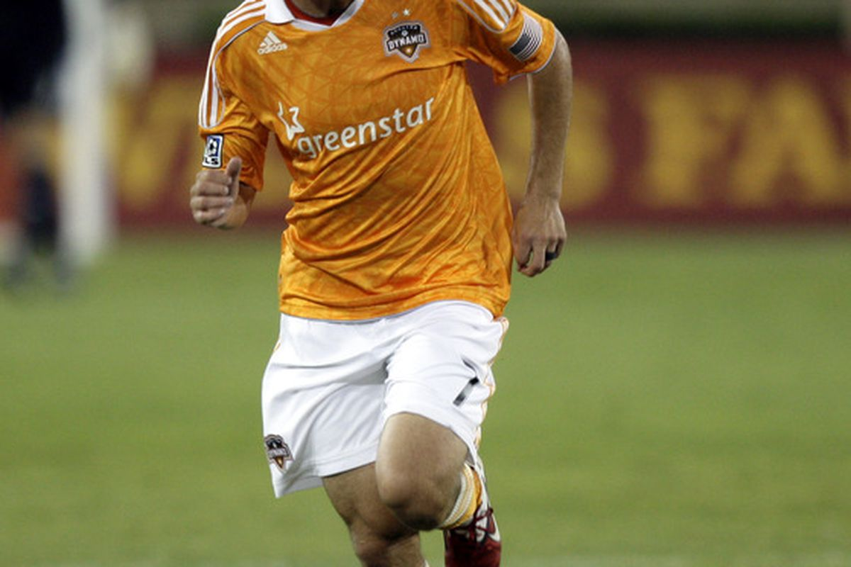 HOUSTON - MAY 04:  Colin Clark #7 of the Houston Dynamo runs downfield after scoring against the Colorado Rapids in the second half at Robertson Stadium on May 4, 2011 in Houston, Texas.  (Photo by Bob Levey/Getty Images)
