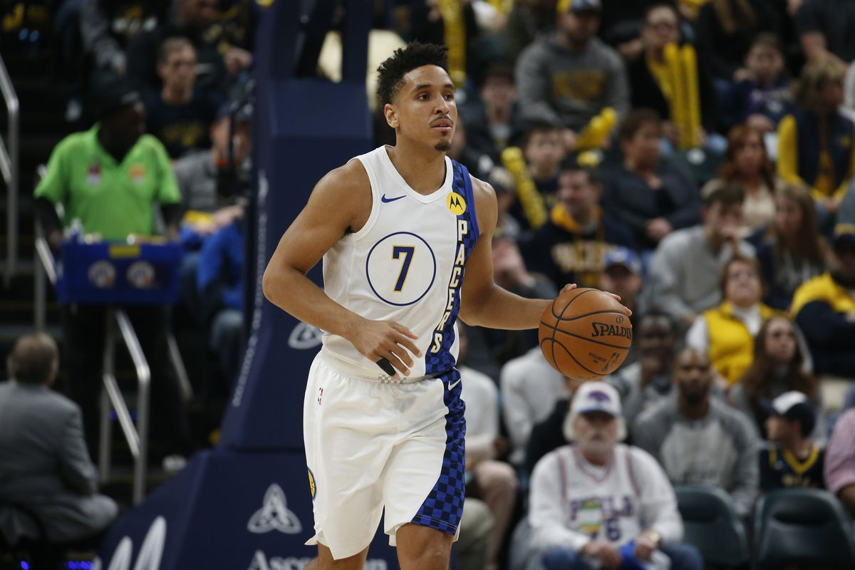 Indiana Pacers guard Malcolm Brogdon brings the ball up court against the Philadelphia 76ers during the first quarter at Bankers Life Fieldhouse.