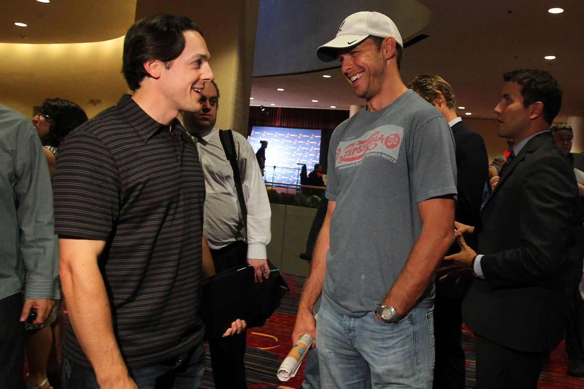 September 12, 2012; New York, NY, USA; NHL players Daniel Briere (left) and Martin Biron (right) talk before registering at the 2012 NHLPA summer player meetings at the Marriott Marquis. Mandatory Credit: Brad Penner-US PRESSWIRE