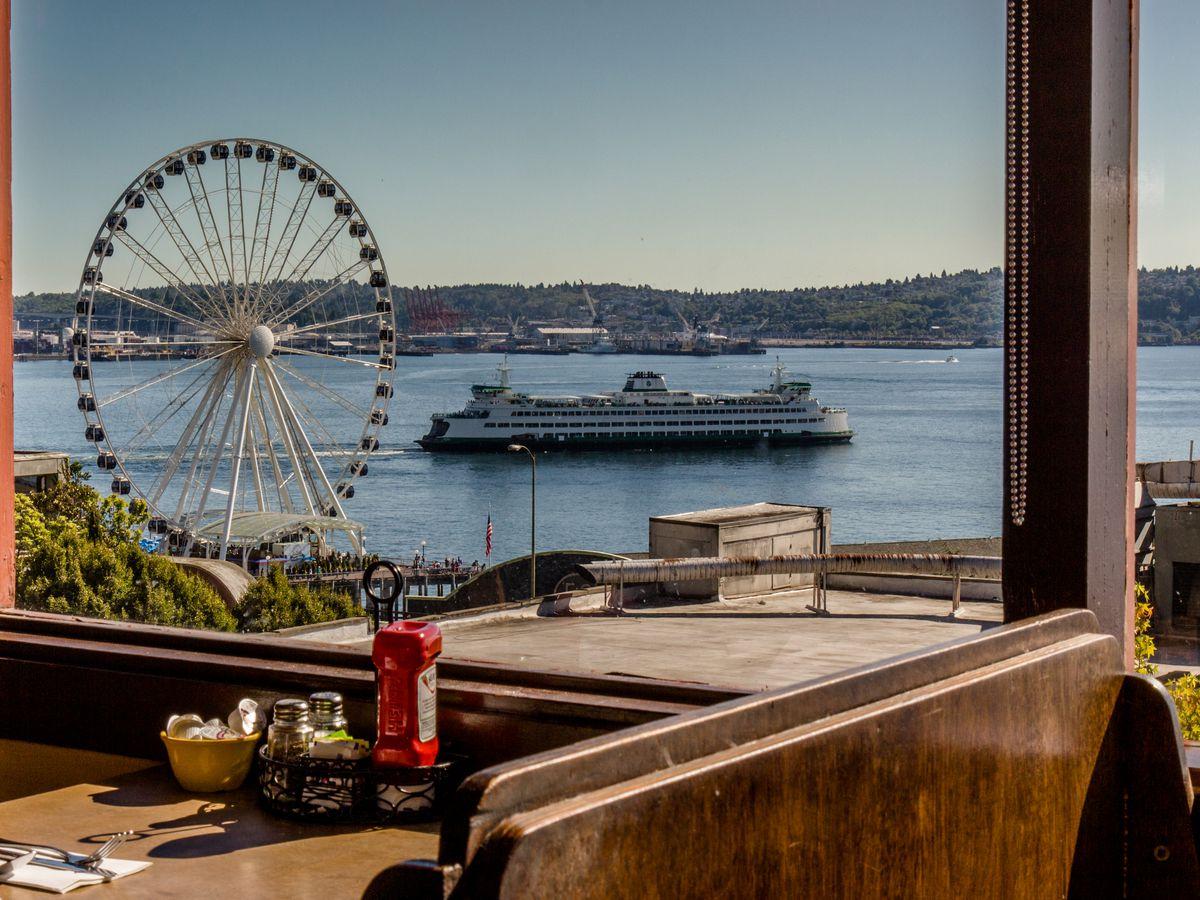 A view of the Great Wheel and a ferry from the Athenian restaurant in Pike Place Market on a clear, sunny day.