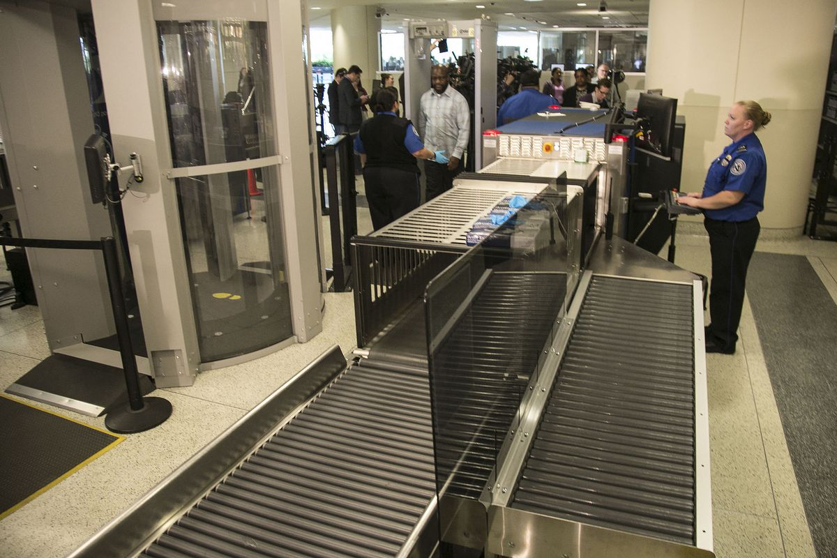 Volunteers posing as passengers move through the security line during a demonstration on TSA prohibited items at Midway International Airport on Thursday. | Ashlee Rezin/Sun-Times